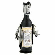 "Steel wine bottle holder with a waiter silhouette.   Product: Wine bottle holderConstruction Material: Steel and nylonColor: Silver and blackFeatures: Waiter silhouetteDimensions: 12.5"" H x 6"" W x 5"" D"