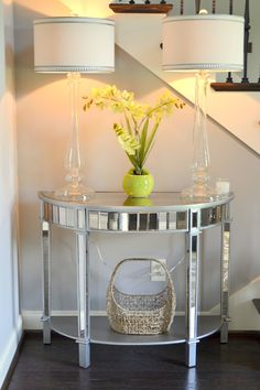Foyer decor using Pier 1 Elegant Glass Candlestick Lamps, Mirrored Console Table and Rattan Basket