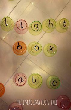 Alphabet Cups on the Light Box - The Imagination Tree