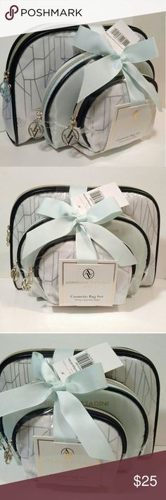Makeup Bag Set Of 3 Brand New With The Tag & Bow Adrienne Vittadini 3 Piece Some Style Makeup Bag Set.  A Really Pretty, Nice & Roomy Set To House All of Your Beauty Traveling Needs.  The Large & Smal