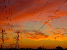 Sunset Fire by suechan_0514  Colours Sky Sunset Clouds Silhouette Lights Orange Power Melbourne Power lines Golden Sunlight Pylon