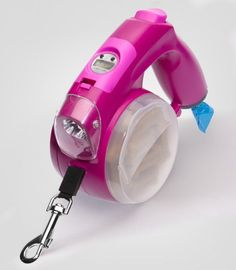 Retractable dog leash with storage container, flashlight, clock, poop bags and a pop out water dish... $26