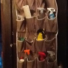 End cleaning supply clutter. Basic over the door shoe holder. Hang in handy spot and fill with cleaning supplies. We hung ours on the cellar door out of the way, but easy to get to. Shoe Holders, Cellar, Clutter, My Recipes, Cleaning Supplies, Fill, Easy, Cleaning Agent