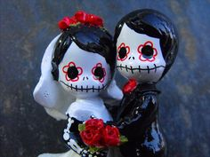 A bit macabre for my taste, but pretty. Day of the Dead WEDDING CAKE TOPPER - 3 inches. $28.00, via Etsy.