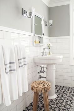 Gorgeous bathroom features upper walls painted gray, Sherwin Williams Gray Clouds, and lower walls . Bathroom Red, Diy Bathroom Decor, Grey Bathrooms, Bathroom Colors, Beautiful Bathrooms, Bathroom Wall, Bathroom Interior, Small Bathroom, 1930s Bathroom