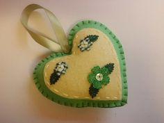 Handmade felt heart in green with flower details by Madeinthehoose