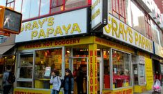 Street view of a Gray's Papaya restaurant in NY, one of the best cheap foods to eat in the city