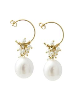 "18ct gold small hooplet with a cluster of tiny white fresh water pearls cascading down on top of a large egg shaped fresh water pearl. This is a classic Sweet Pea pearl earring that is timeless and perfect for various occasions from bridal jewelry to a fresh and sophisticated look.     ?Measures: pearl drop: 0.31"" x 0.47""; hoop is 0.59""    Gold Pearl Earrings by Sweet Pea Fine Jewellery. Accessories - Jewelry - Earrings - Statement Primrose Hill, North London, London"