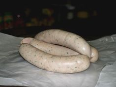"""Weisswurst: Traditional Bavarian """"white sausage"""" made from very finely minced veal and fresh pork bacon. It is usually flavoured with parsley, lemon, mace, onions, ginger, and cardamom, although there are some variations White Sausage, German Sausage, Cooking Beef, Smoker Cooking, Sausage Making, How To Make Sausage, Bratwurst Recipes, Sausage Recipes, Pork Bacon"""