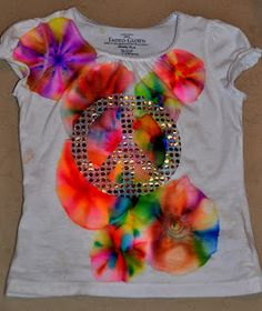 Make your own AWESOME tie dye circular pattern with rubbing alcohol, a plastic cup, rubberband, and permanent markers.