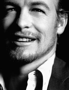 Simon Baker...not so much the color of his eyes, but the little crinkles at the corners.  :)