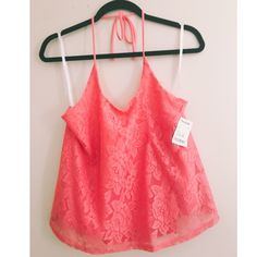 Coral Tank Top!  Bought this at marshalls last Summer, didn't come around to wearing it! Still new, but has a slight stain or somthing, on the front, which I don't think is noticeable. Really a nice top for the summer! Size large.  Tops Tank Tops