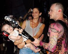 Flea's daughter Sunny Bebop Balzary tunes her dad's bass guitar.