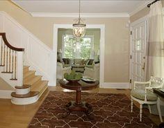 Entry, sisal stair runner, light fixture, front door, chair - The Best Benjamin Moore Paint Colors: Shaker Beige HC-45