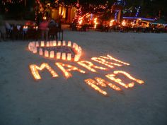 Is this not the cutest way to propose...on a beach with illuminarias at night???