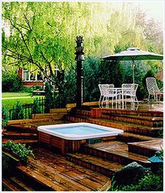 backyard project idea. beautiful layered hot tub deck with dark ... - Spa Patio Ideas