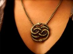 The Neverending Story pendant. If I ever see someone of the female species walking around with this, I will have to marry her!