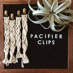 Color: Beige/off white Materials: 100% cotton macramé string from @Niromastudio, brass pacifier clips Measurements: 10 inches