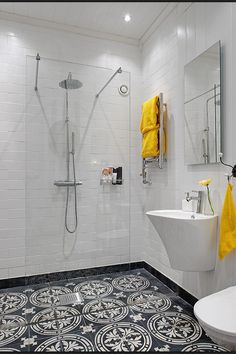 Floor to ceiling white subway + mosaic tile