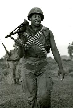 A trooper from the 82nd Airborne Division carries an M-60 machine gun during the Vietnam War. / Credit: The Fayetteville Observer files