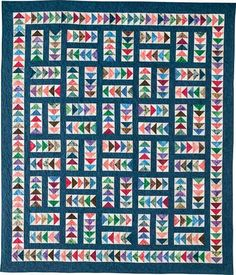 Sew Many Geese Quilt Kit: Sew up a gaggle of Flying Geese from an array of colorful batik fat quarters for this scrappy twin quilt designed by Monique Dillard.