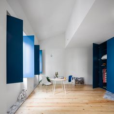 Blue shutters conceal kitchens and windows in Porto flats by Fala Atelier Blue Shutters, Pantone 2020, Minimalist Pattern, Cute Dorm Rooms, Color Of The Year, Cushions On Sofa, Pantone Color, White Walls, Colorful Interiors
