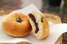 Anpan - sweet roll filled with red bean paste (which is sweet). It can also be filled with white beans, sesame, and chestnuts. They're are nice and portable, though I think I'd like the fluffy roll rather than some of the bagel like one's I've seen.