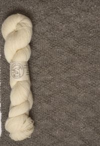 A free knitting pattern for a block-of-the-month afghan featuring Sport Weight Custom Spun by Glenfiddich Wool!