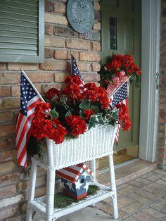 White wicker planter with red geraniums & flags for the porch! Fourth Of July Decor, 4th Of July Decorations, 4th Of July Party, 4th Of July Wreath, July 4th, Holiday Decorations, Memorial Day Decorations, Outdoor Decorations, Birthday Decorations