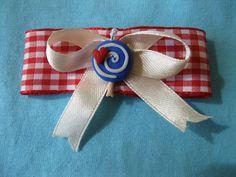 Fiocco per capelli (mollettina) cucito a mano, con lecca lecca in fimo (la spirale bianca si illumina al buio)