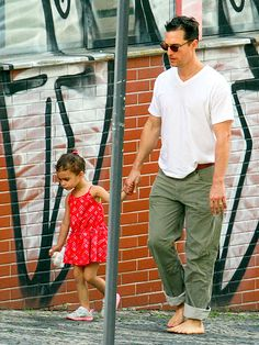 Matthew McConaughey stays in step with little lady Vida, 3½, during a father-daughter stroll through Belo Horizonte, Brazil, on December 24, 2013.