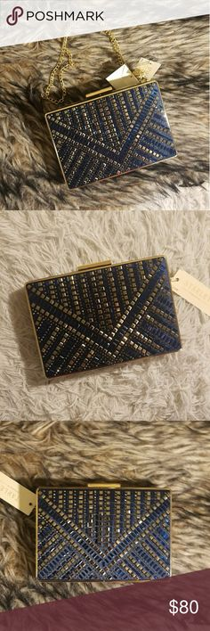 Starlett crystal navy hold clutch purse bag NEW New with tags Starlet brand blue and white crystal embossed rhinestone gold rectangular clutch it has a snap closure and a satin inside there is a gold chain strap it's really elegant and beautiful and I'm so gorgeous detail made very well nice and sturdy if you like it feel free to make an offer but no trades starlett Bags Clutches & Wristlets