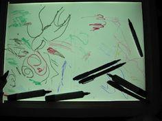 Mark-making on the light box. | Pre-school Play
