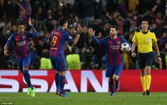 Neymar, Luis Suarez and Lionel Messi exchange high fives after the Argentine's penalty put Barcelona 3-0 up on the night