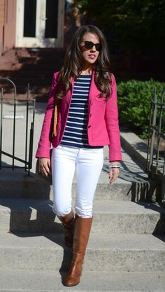 pink blazer, navy blue and white striped shirt, white pants and brown riding boots.  Lovely outfit!