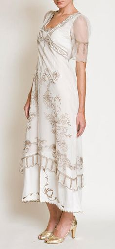 The beautiful 1920s and 1930 soutache embroidery adorns this styles throughout and Victorian lace covers the many layers of the dress _ wardrobe shop