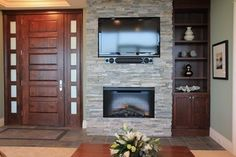 Tv mounted above fireplace in living room