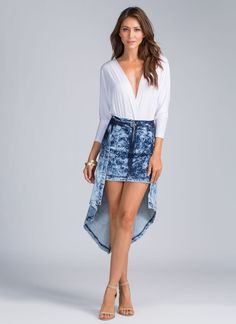 n our world, denim skirts aren't always perfectly even. Case in point: This rad, asymmetrical one.