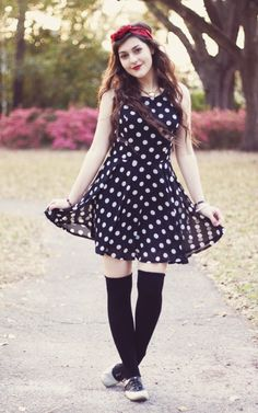 This outfit is so cute! Love the polka does and the knee socks and oxfords!! This girl has an amazing blog! It's called a walk in the park