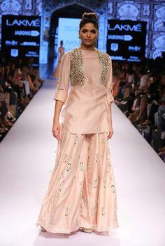 Payal Singhal Indian Wear Collection : : Jodha Sharara : Blush Silkmul Roll-up Sleeve Kurta & Embroidered Sharara Pants Worn With Mirror Cutwork Short Jacket. Pakistani Dresses, Indian Dresses, Indian Outfits, Indian Clothes, Indian Attire, Indian Wear, Lakme Fashion Week 2015, Look Short, Lehenga Gown