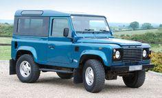 Land Rover Defender 90 Td5 Sw Se County in blue.