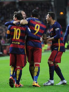 Luis Suarez of FC Barcelona celebrates with Lionel Messi after scoring his team's 3rd goal during the La Liga match between Sporting Gijon and FC Barcelona at Estadio El Molinon on February 17, 2016 in Gijon