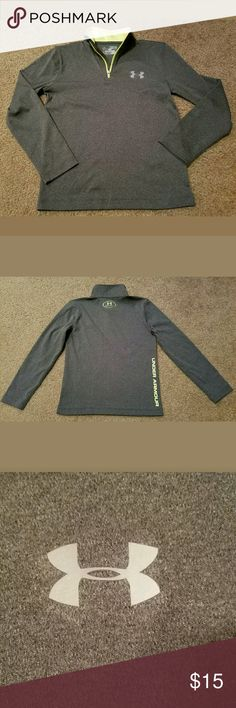 Under Armour Heatgear Loose Boy's 1/4 Zip Pullover This is a really great pre-owned Under Armour Heatgear Loose Boy's 1/4 Zip Pullover Size YXS. It is excellent pre-owned condition. There are no holes, stains, rips or tears anywhere in the fabric. It is a charcoal gray in color with neon yellow accents. It is practically like new.  Measurements are: Armpit to Armpit: 15.5 inches  Length: 19 inches  Sleeve: 16 inches Under Armour Shirts & Tops Tees - Long Sleeve
