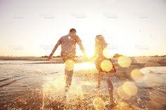 couple running on the beach stock photo 23790927 - iStock