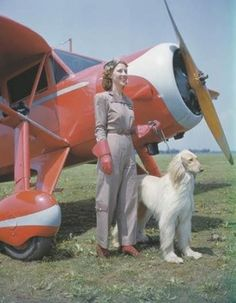 """Early aviatrix Marion Florsheim with Afghan (c 1937 Hans Groenoff, National Air and Space Museum). Marion became a follower of Meher Baba and he named her """"Energy""""."""