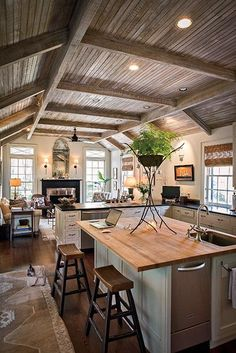 Photos: Georgia River House | Garden and Gun | Bob Christian Faux painted a kitchen ceiling to resemble weathered cypress