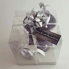 1 Small Wax Burner, 1 Tealight and 1 Set of Wax Melts in an Organza Pouch, beautifully presented in a transparent plastic box (9x9x9 cm), and finished with ribbon and a bow.  Tag messages available: Ramadhan Mubarak, Happy Birthday, Thank you, Eid Mubarak, With Love. Please send us a contact form with your desired option after placing your order. Personalised tags can be provided on an order of 15 or more favours, max. 24 characters.