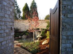 beautiful stone wall and gate into a dream courtyard... breathtaking!!