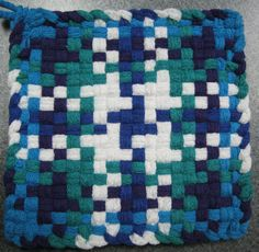 Thick cotton potholder made with high quality cotton loops. Size approximately 6 inches square. Handmade cotton looped potholders last for years and add a cozy, homey touch to your kitchen. Like a bright white star cluster in a rich dark sky, this potholder stands out. Machine wash cold. Reshape dry flat.
