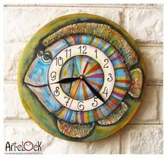 wall clock, wood clock, hand painted clock, fish, kitchen, blue red Striped, Spring Trends 2016, wall clock handmade, handpainted clock, spring gift, fishing gift clock, green clock  ArtClock perfects itself and tries to do all it can to satisfy you with purchase.  This wall art clock is completely painted by hand. The plywood clock-face (6 mm thickness) is acrylic painted.  The clock-work has a hook for wall fastening. AA battery puts in motion the clock (no switch off). This clock is…
